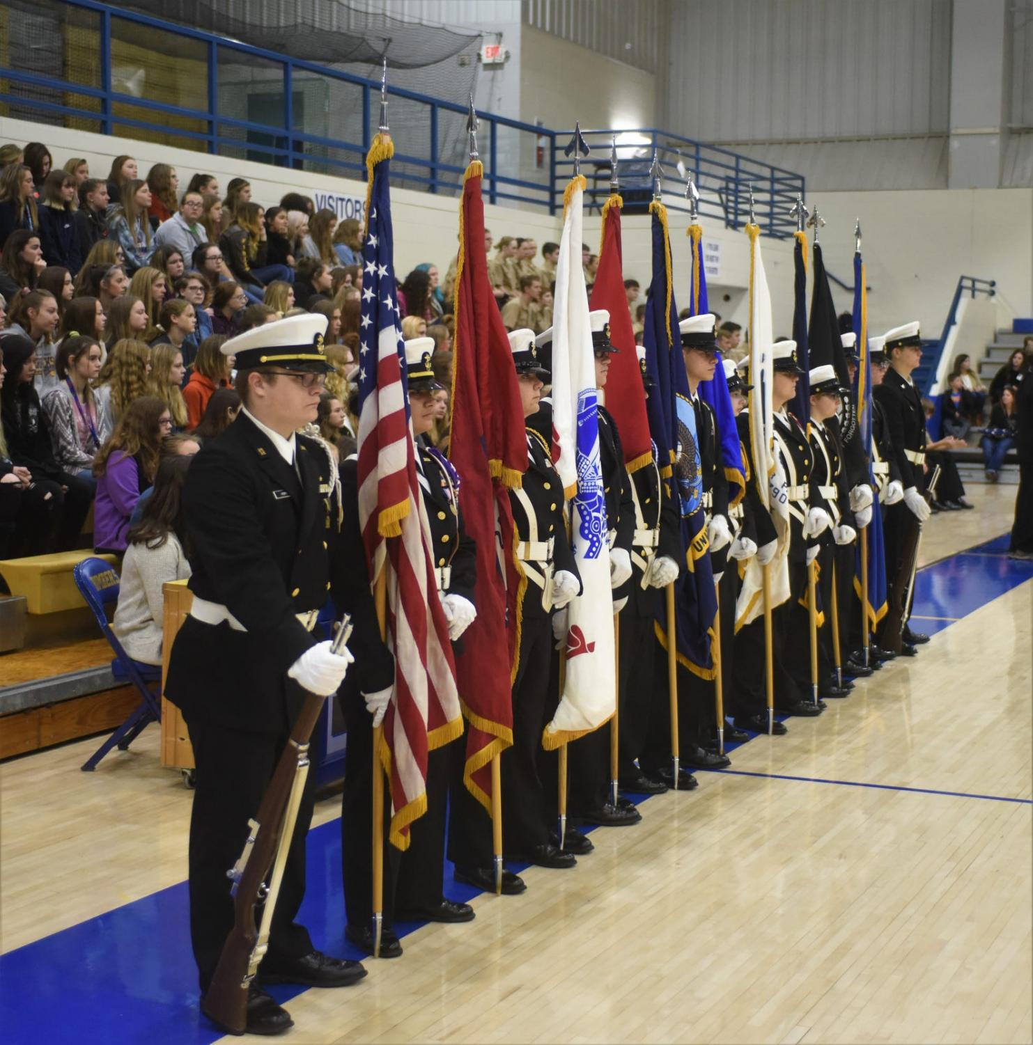 MHHS NJROTC cadets present flags during