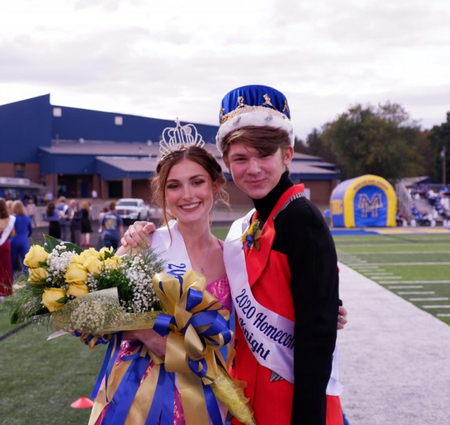 Crowning glory. Homecoming Queen Savannah Scott and King Levi Priborski enjoy a moment on the sidelines after the coronation.